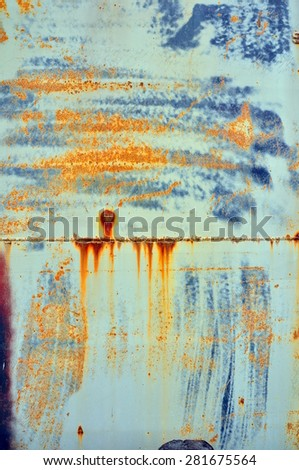 Blue and brown rusted panel - stock photo
