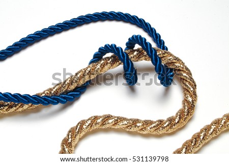 blue and golden rope on white