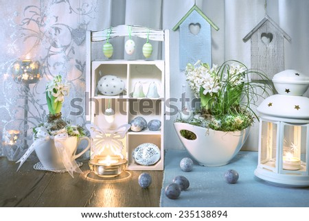 Blue and green Easter decorations with hyacinth flowers - stock photo