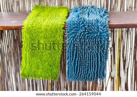 Blue and green hanging cleaning mop - stock photo