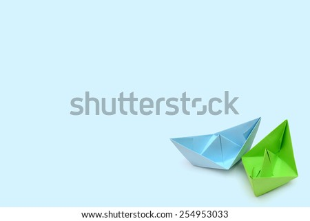 Blue and green paper boats, origami