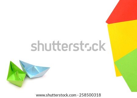 Blue and green paper boats, origami, paper sheets, color paper sheets - stock photo