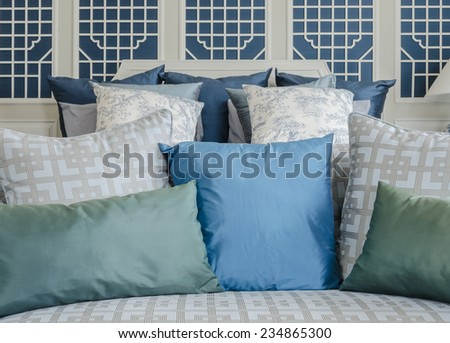 blue and green pillow on bed in luxury bedroom at home - stock photo