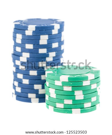 Blue and green stacks of poker chips isolated on white background