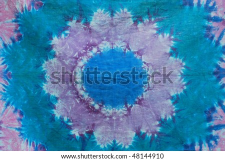 Blue and lavender abstract tie dye design on cotton fabric. - stock photo