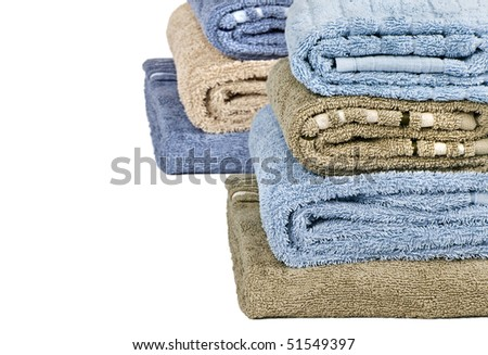 Blue and light brown clean towels stacked up - stock photo