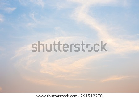 Blue and orange sky with clouds background. - stock photo
