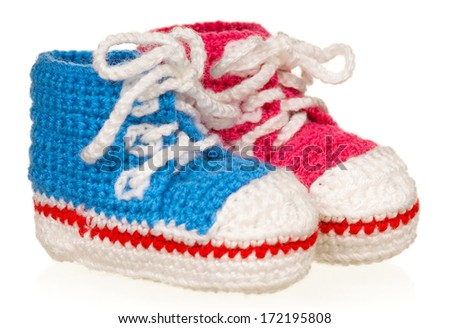 Blue and pink baby booties isolated on white background - stock photo