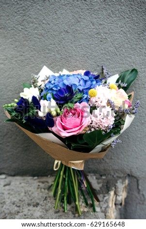 Blue pink bouquet flowers wrapped paper stock photo 629165648 blue and pink bouquet of flowers wrapped in paper bunch of fresh blue hydrangea mightylinksfo Gallery