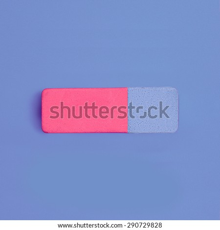 Blue and pink rubber pencil eraser view from above on colored background - stock photo