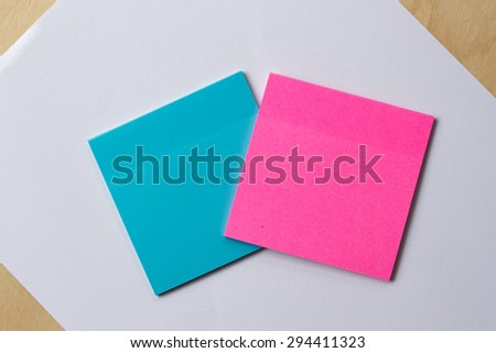 blue and pink sticker paper note on white paper