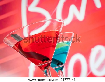 blue and red cocktail drink with space for text, disco atmosphere