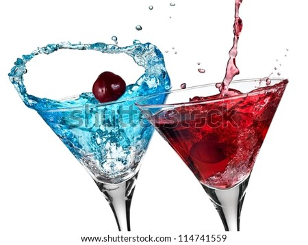 Blue and red cocktail with cherry splash