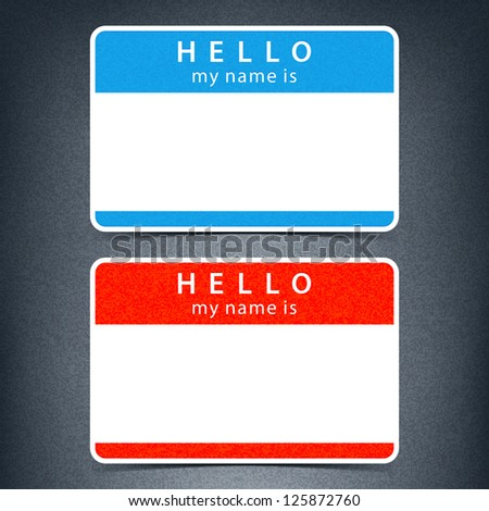 Blue and red name tag blank sticker HELLO my name is with drop black shadow on dark gray background with noise grain texture. This image is a bitmap copy my vector illustration