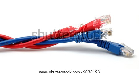 Blue and red network cables in isolated white background - stock photo
