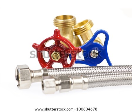 Blue and red plumbing valves with metal hoses - stock photo