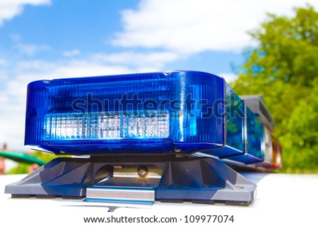 Blue and red police roof bar lights - stock photo