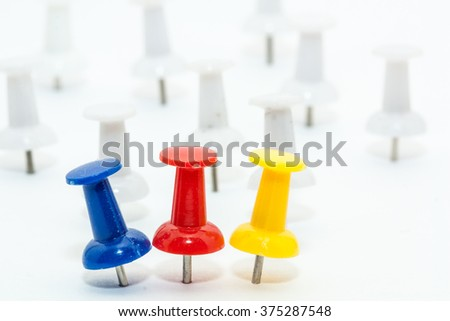 Blue and Red push pins with white pins as back ground - stock photo