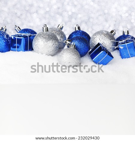 Blue and silver christmas balls and decoration on snow - stock photo