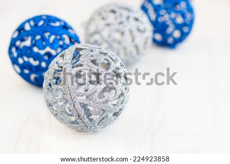 Blue and silver Christmas spheres on a white surface - stock photo