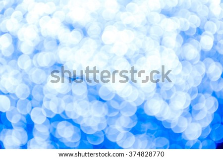 blue and silver Sparkling Lights Festive background with texture. Abstract Christmas twinkled bright background with bokeh defocused lights and Falling stars. Winter background. Card or invitation. - stock photo