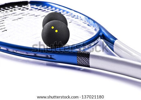 Blue and silver squash racket and ball on a white background with space for text - stock photo