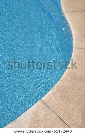 blue and vibrant swimming pool side - stock photo