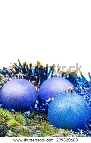 blue and violet Christmas balls on green spruce branch isolated on white background - stock photo