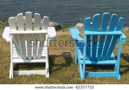 Blue and White Adirondack Chairs - stock photo