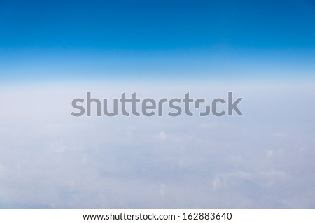 Blue and White background - view from plane - copyspace for advertisement - stock photo