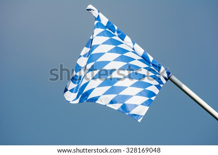 Blue and white bavarian flag blowing in the wind - stock photo