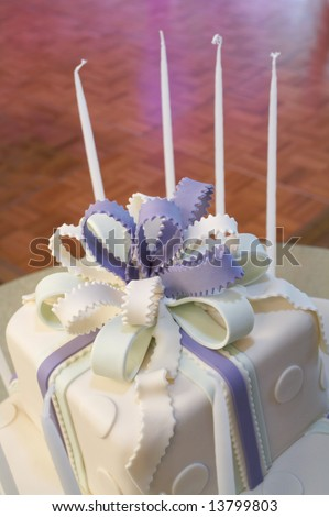 Blue and white cake with candles at bat mitzvah