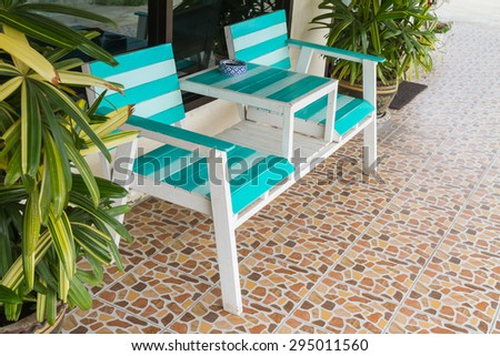 Blue and white chairs in front of the house for relaxation - stock photo