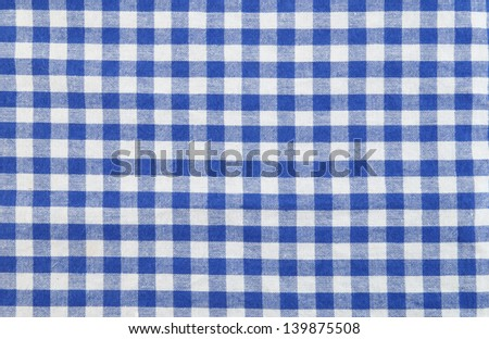 Blue and white checked tablecloth background - stock photo