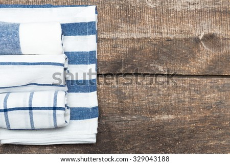 Blue and white checkered tablecloth on wooden table