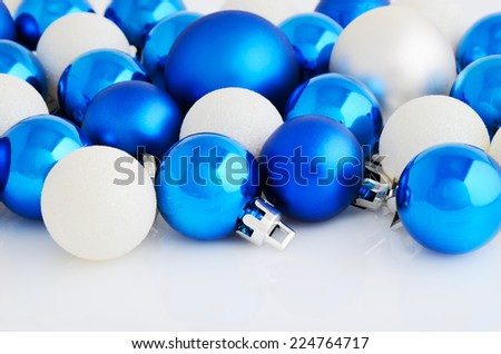 Blue and white christmas balls on the white background horizontal