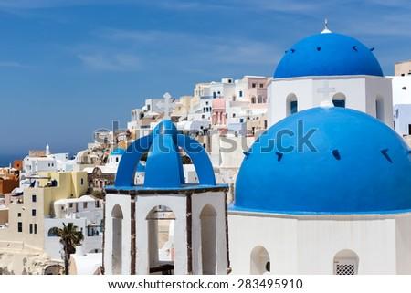 Blue and white church of Oia village on Santorini island. Greece - stock photo