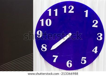 blue and white circular analog wall clock - stock photo