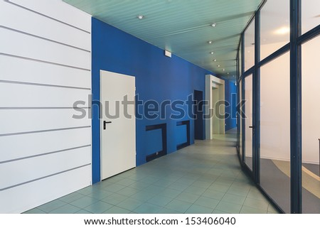 Blue and white corridor in a company building - stock photo