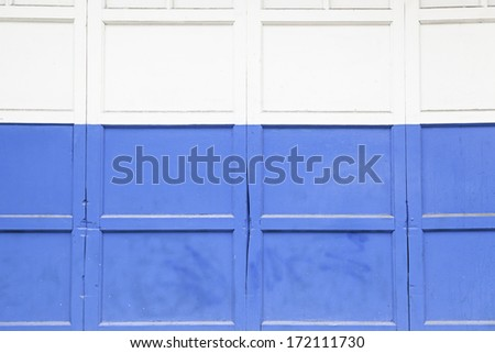 Blue and white door, detail of a door in a city, painting and decoration, protection, closed - stock photo