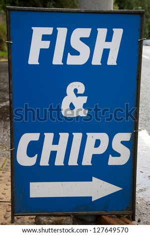 Blue and White Fish and Chips, Sign - stock photo