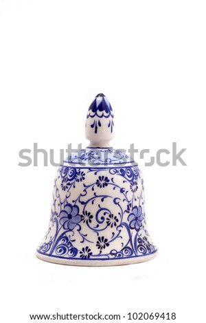 Blue and white hand-painted ceramic bell - stock photo