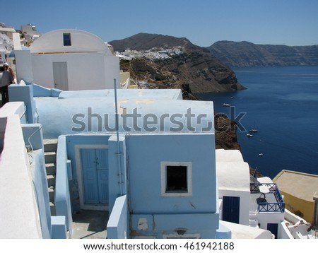 blue and white homes on caldera