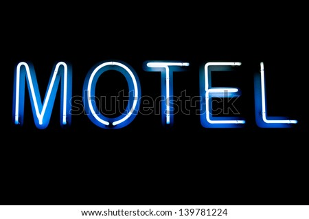 blue and white motel neon sign (isolated on black background) - stock photo