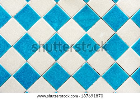 Blue and white of diamonds pattern tile wall. - stock photo