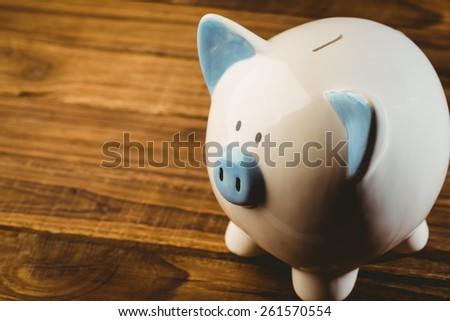 Blue and white piggy bank shot in studio - stock photo