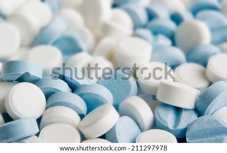 Blue and white pills background - stock photo