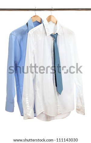 blue and white shirts with tie on wooden hanger isolated on white - stock photo
