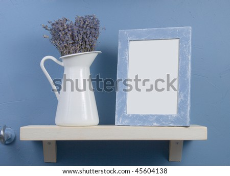 Blue and white still-life with lavender and frame - stock photo