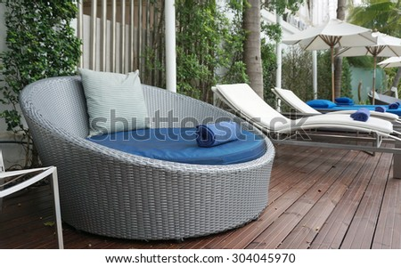 Blue and white stripe cushion on blue beach bed with grey plastic woven backing